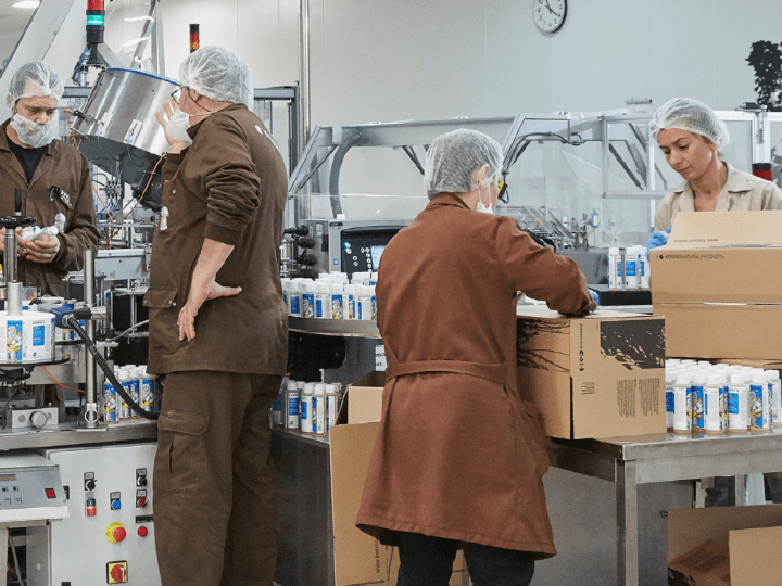 photo of a diverse team working in a manufacturing plant